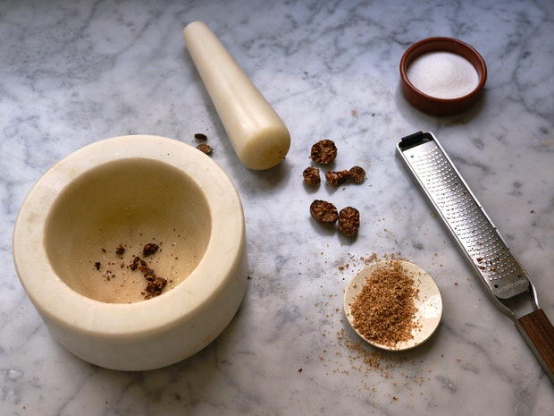 Grating Nutmeg with Microplane Grater for Butter Cake