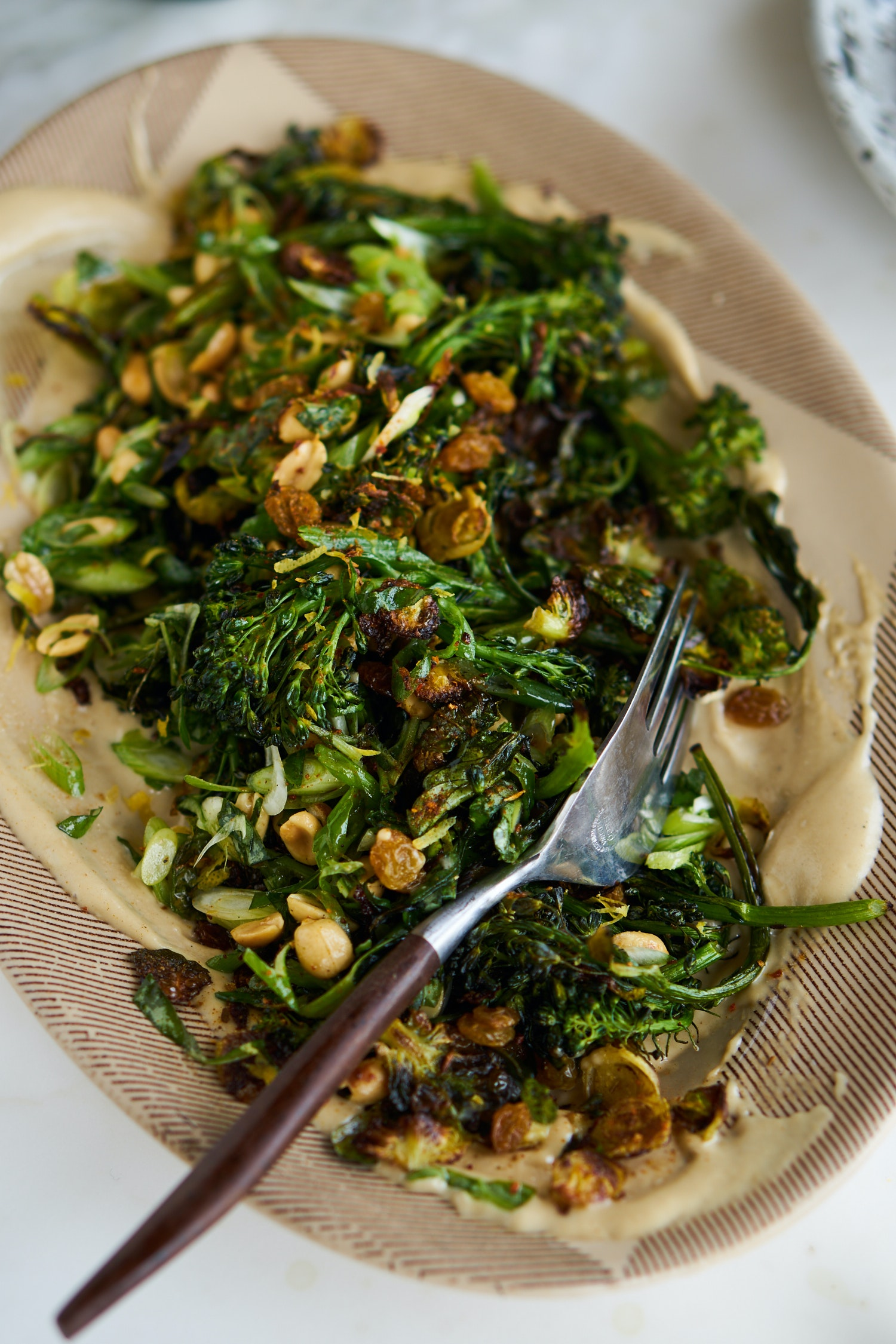 Curried Sheet Pan Broccoli with Peanuts and Tahini