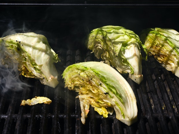 Wedge lettuce cut into quarters, ready to serve
