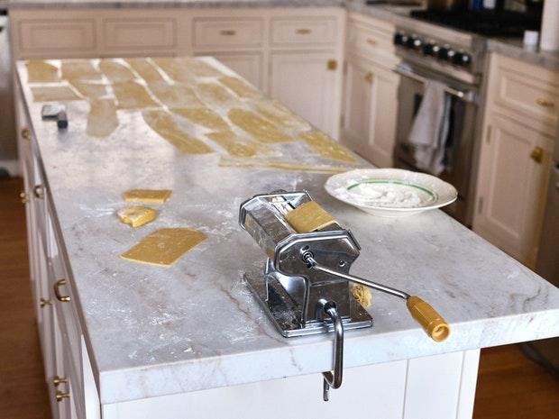 Pasta Machine in Process of making Pasta Sheets for Lasagna