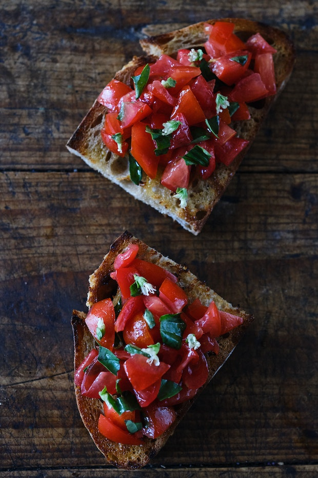 Simple Bruschetta with Ripe Red Tomatoes and Basil