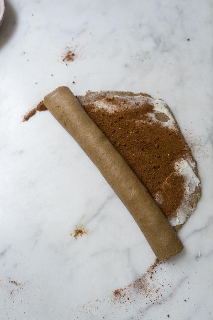 Cinnamon Rolls being Filled with Cinnamon Sugar