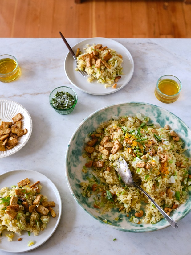 Super Orange Citrus Rice Surrounded by Plates and Ready to Eat