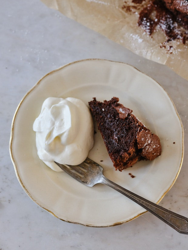 A Slice of Flourless Chocolate Cake on a Small White Plate
