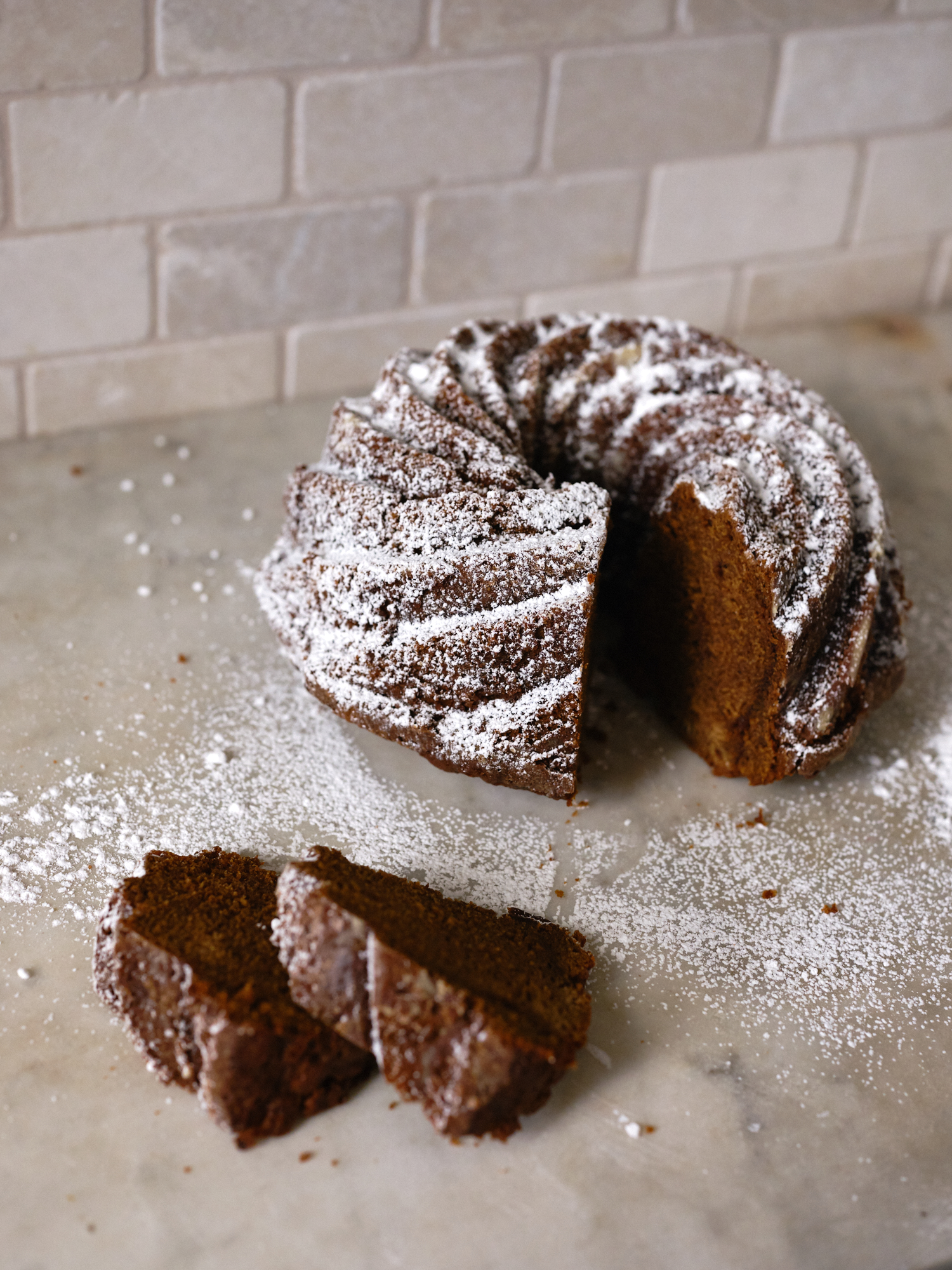 Black Sticky Gingerbread Dusted with Powdered Sugar
