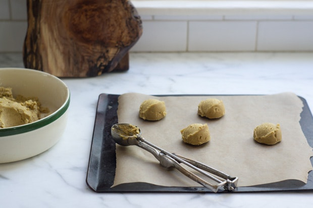 Snickerdoodle dough on baking sheet with Ice Cream Scoop as dough Scooper